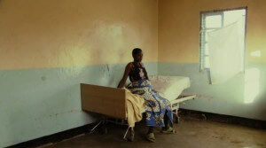 Janet sits in the small Tanzanian clinic waiting for the birth of her child. (everymothercounts.org)