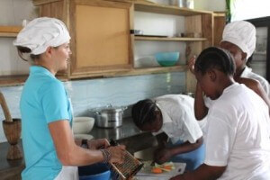 Opportunity-US staff member Abbi with the girls in the kitchen.