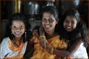Jayanthi, a loan officer at Opportunity India's Saidapet branch, started as a Trust Group client. She's pictured here with her two young daughters Lavanya and Abinaya.