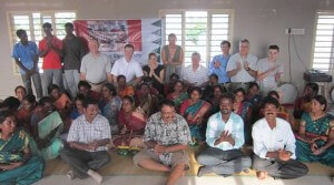 Travelers, Trust Group members, and Opportunity India staff gather for a group shot.