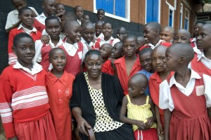 School proprietor and client Rosemary Namande, with students of the Nadulu Infant Primary School in Kampala.