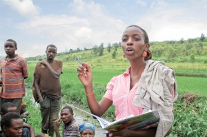 In Rwamagana, Rwanda, Alice Cyanzayire reviews fertilizer needs with local rice farmers.