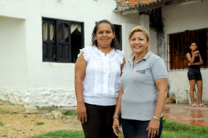 Beduith (left) and her Opportunity Colombia loan officer.