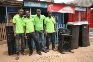 Edward (second from right) and employees at his shop.