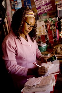 Felicitus Mmboge working in her Nairobi shop.
