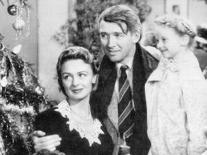 "Donna Reed, Jimmy Stewart and Karolyn Grimes in ""It's a Wonderful Life"" (1946)."
