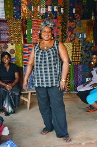 Opportunity client Patience Dameh sells fabric out of one of the most vibrant stalls in the Kasseh Market in Ada, Ghana.