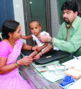 When her baby was sick, Deepa Kahar's (left) health insurance through Opportunity covered treatment and medicine.