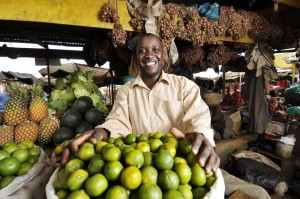 Client Godfrey Lutwama in the Kalerwe Market in Kampala, Uganda.