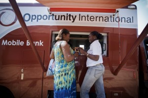 Cocoa farmer Beatrice Boaten (left) at a mobile banking van in Kumasi, Ghana, with her loan officer Abena Sarpong.