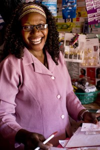 Felicitus Mmboge keeps her money safe and secure and her business is a success in her Nairobi, Kenya shop.