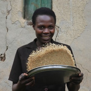 Rwandan rice farmer Elina Uwingeneye is an agricultural finance client who uses loans to grow more crops with better fertilizers, increasing yields.
