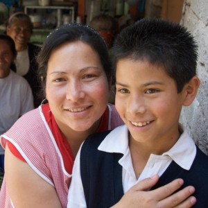 Loan client Maria Elena Tovar Gonzalez, from Guadalajara, Mexico, poses with her son. 93% of Opportunity's loans go to women like Maria around the world.