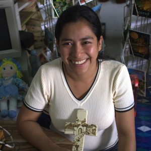 Experienced artisan Maria de los Angeles Ordjonez carves elaborate designs into decorative pieces and household items to sell in her Honduras village.