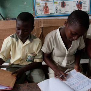 Bright Ofori (left) and Clementina Dankwa learn at the Richmercy School, Ashaiman, Ghana, where proprietor Mercy Senyegah receives loans to improve her school.