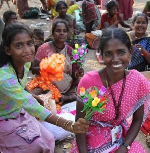 A client who makes jewelry surprises loan officer Valamarthi with a beautiful bouquet in Chennai, India.