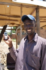 Opportunity Malawi savings client & maize wholesaler Joseph Meke uses the M'ganga service to check his account balance every day by cell phone, makes deposits at Opportunity's Ndirande satellite branch, and uses a point-of-sale (POS) device in nearby Ntcheu to withdraw cash.