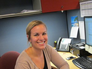 Lauren Hawley at her desk, in her new role, in our Oak Brook office.