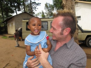 My favorite picture! Roberto and a little girl at the Faraja Centre.