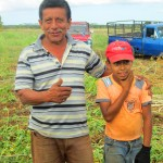 Client Eduardo Chavarria and his grandson, who loves to help out in the yucca fields after school, in Granada, Nicaragua.