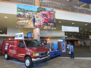 Opportunity's Willow Creek booth, complete with a life-sized model of a mobile banking van.