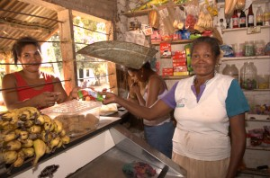 Client Argelia Ramirez (right), a shop owner in Henequen, Colombia, now has a safe place to save.