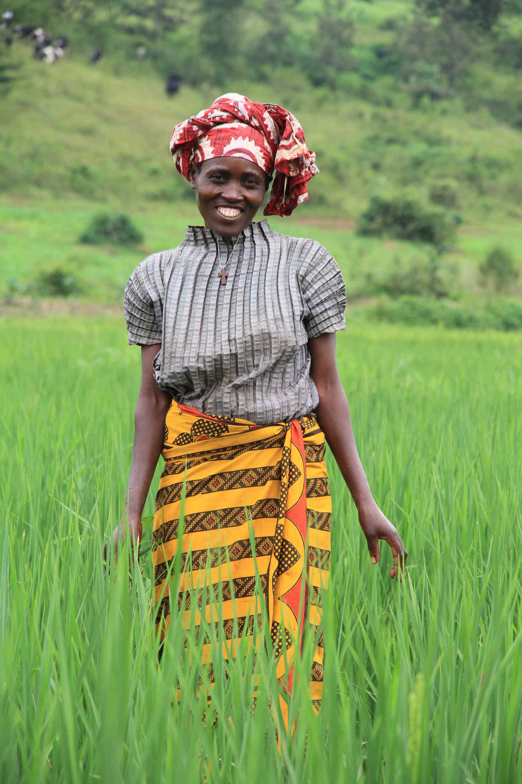 Opportunity clients like rice farmer Eugenie Nyirabagenzi, in Rwamagana, Rwanda, use microloans to grow their businesses and buy more seeds to produce better crop yields to feed their families and their communities.