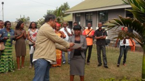 DR Congo CEO Gilbert Lagaillarde distributes certificates to the staff who participated in the workshop.