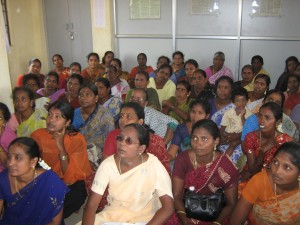 Clients receive orientation for Opportunity India's housing loan program in June 2012.