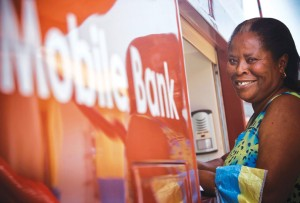 Beatrice Boaten accesses her savings account at a mobile bank.