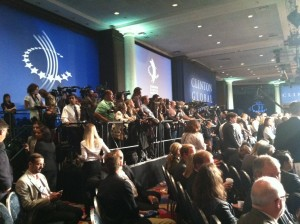 The press gather in preparation for Pres. Obama's remarks at the afternoon plenary session.