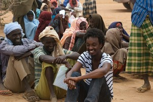 Musician K'naan with refugees waiting for tents.