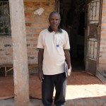 Josephat Nivin, in front of his home in Kinyamakobe, Uganda.