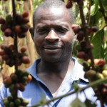 Mubende coffee farmer Rapheal Kulumba with coffee cherries.