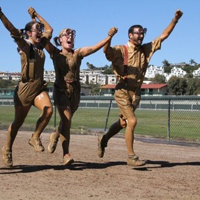 YAO-LA member Alison Oviedo ran in the mud with friends to celebrate graduation and raise money for Opportunity.