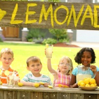 Stores in Washington set up tables and stands downtown and encouraged kids to come sell lemonade for a charitable cause.
